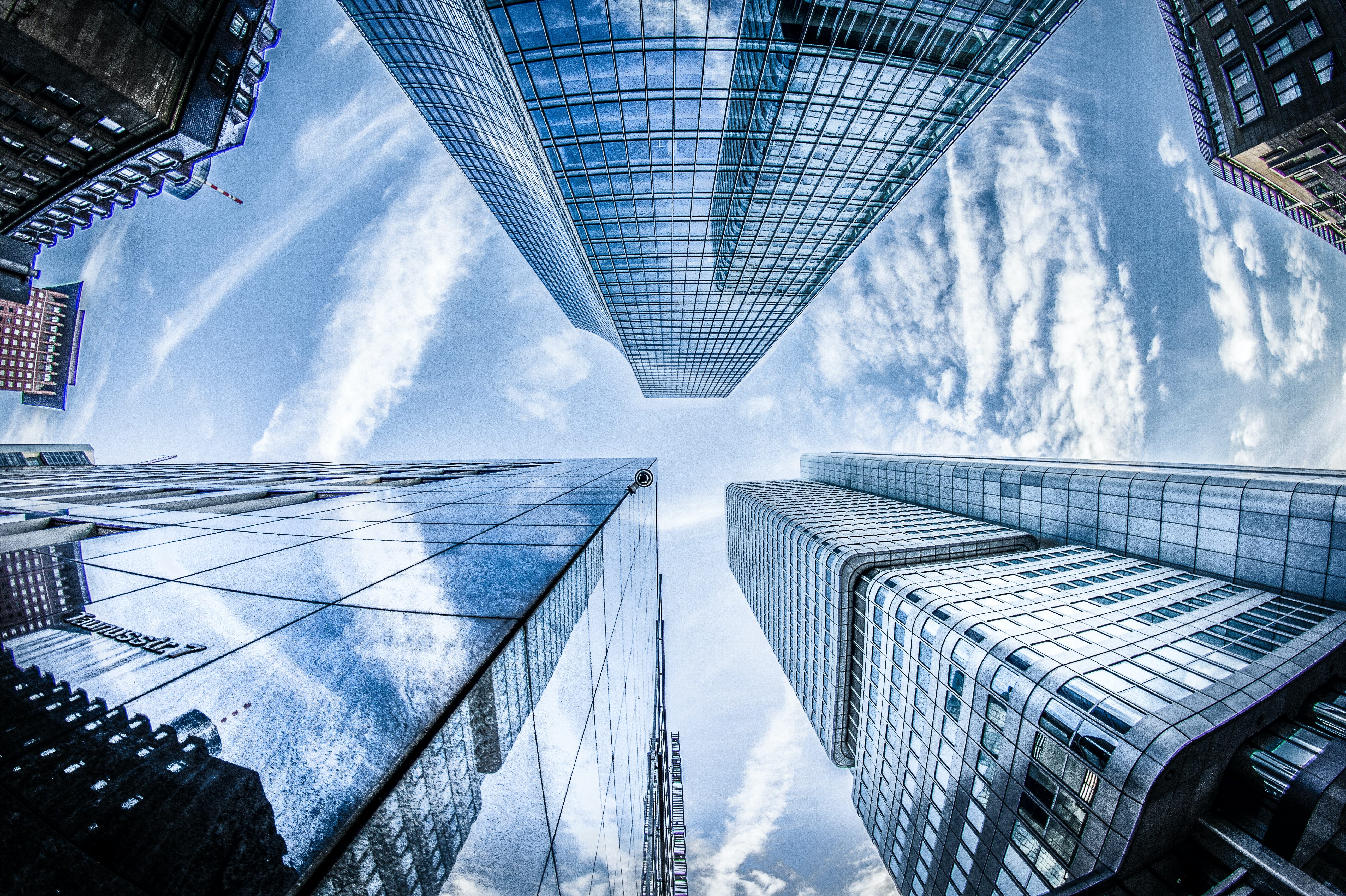 low-angle-photo-of-four-high-rise-curtain-wall-buildings-830891